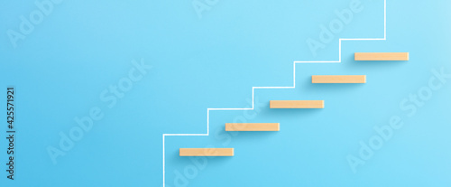 Slika na platnu Ladder of success in business growth concept, Wooden block stacking as step stai