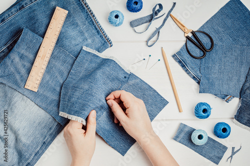 Old jeans upcycling idea. Crafting with denim, recycling old clothers, hobby, diy activity. Sustainable, zero waste lifestyle concept