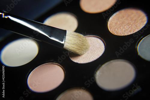 Valokuva Set of eyeshadow pastel shades and makeup brush
