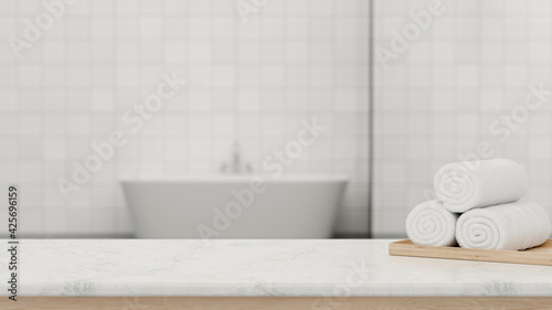 Foto 3D rendering, marble counter in modern bath room with white towels and copy spac