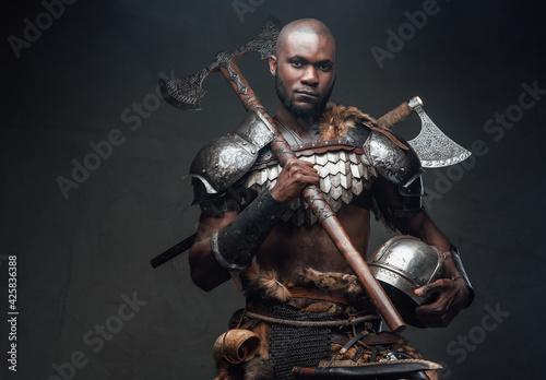 Fotografie, Obraz Dangerous equipped antique warrior with helmet and axe