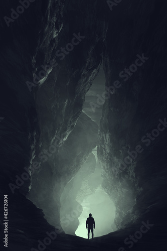 Photo silhouette of a man in a cave, surreal underground landscape