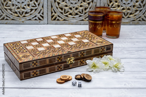 Canvas Oldest known board games Backgammon with cups of tee.