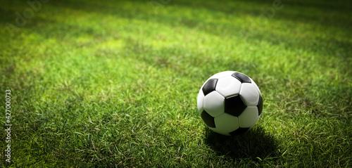 Valokuvatapetti Football soccer ball on grass field