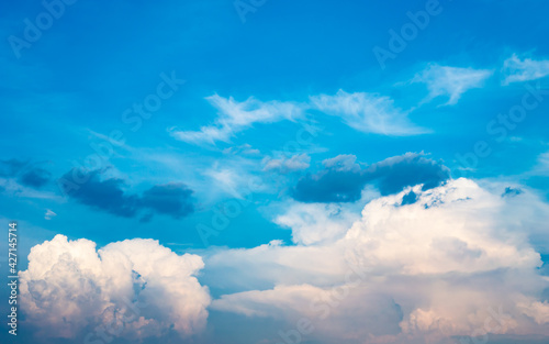 Abstract white fluffy clouds and  Blue sky in sunny day background.Natural Celestial World  concept with blue sky and clouds  Use as background.