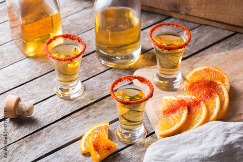 Fotografie, Obraz Mexican mezcal or mescal shot with chili pepper and orange