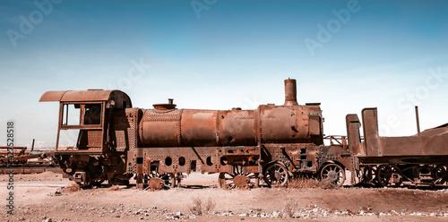 Fototapeta Old rusty steam train near Uyuni in Bolivia. Cemetery trains.