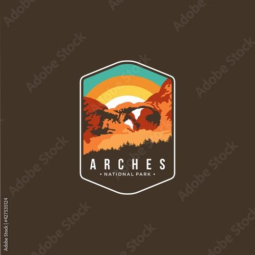Photo Illustration of arches national park emblem patch logo on dark background