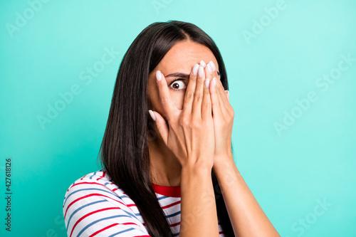 Valokuvatapetti Portrait of stressed brunette hairdo lady cover face wear colorful t-shirt isola