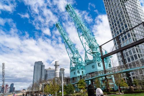 Fototapeta Brooklyn, NY - USA - April 17, 2021:The Gantry Cranes at the north end of Domino Park