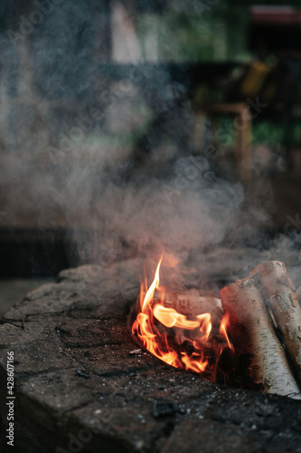 Canvas Print Flame and smoke of fire in the stone hearth