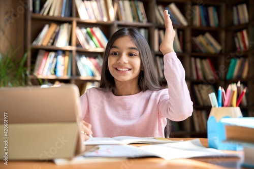 Tableau sur Toile Happy smiling arab indian girl student attending learning video class webinar in virtual classroom on digital tablet device