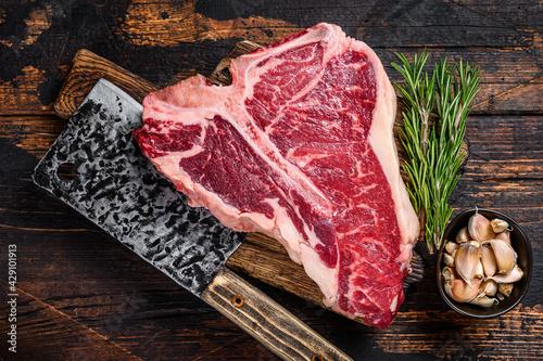 Fotografiet Italian Florentine T-bone beef meat Steak with herbs on a wooden cutting board
