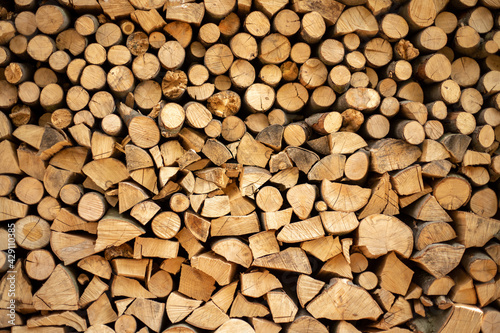 Fototapeta wall firewood , Background of dry chopped firewood logs in a pile