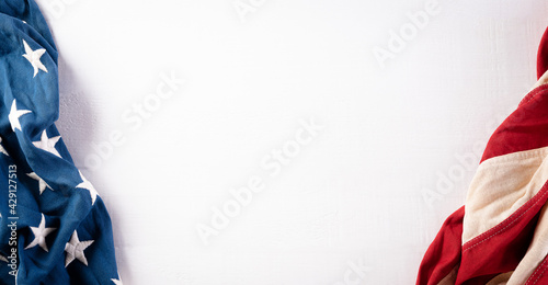 Happy memorial day concept made from american flag on white wooden background.