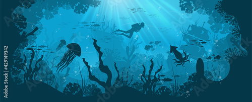Fotografia, Obraz Silhouette of coral reef with fish and scuba diver on a blue sea background