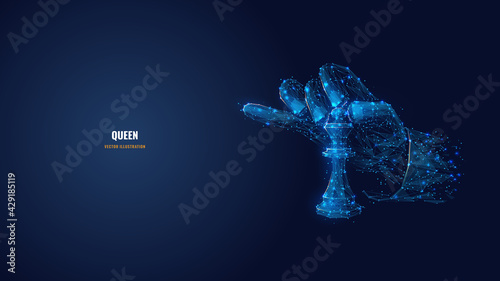 Fotografie, Obraz Abstract 3d hand holding chess piece queen isolated in dark blue background
