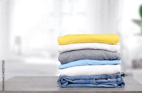 Stampa su Tela Stack of cotton colorful clothes on table indoors