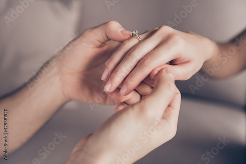 Cropped close-up view of hands girl receiving ring from guy fiance propose momen Fototapeta