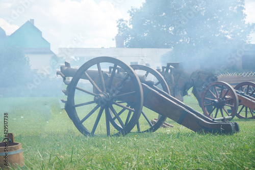 Canvas Print Landscape of old cannons covered with smoke in Germany