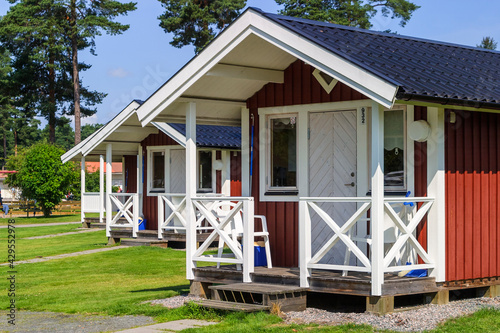 Fototapeta Small Holiday cottages on a camping ground