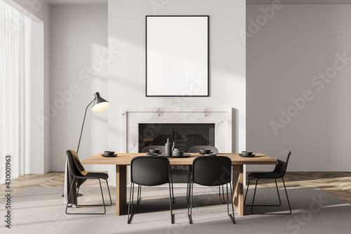 Obraz na plátne Light dining room interior with fireplace and minimalist furniture, mockup poste