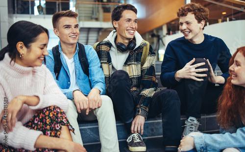 Fotografija Group of students in campus sitting
