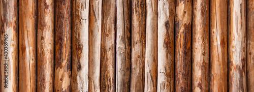 Fotografija wooden texture, pine logs. Fence
