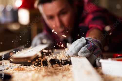 Fotografering Young carpenter working in workshop