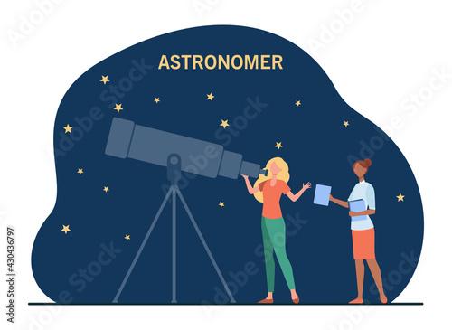 Fotografiet Female astronomers watching stars in telescope