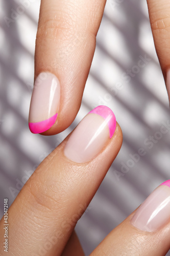 Hands with bright pink french manicure Fototapet
