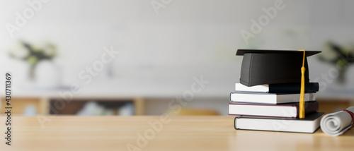 Fotografia Graduation concept, 3D rendering, graduation cap on stack of books on the table