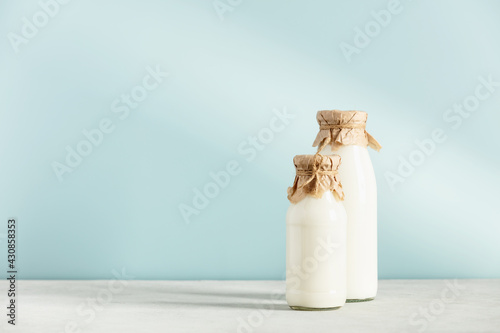 Canvas Print on dairy plant based milk in bottles and ingredients on blue background