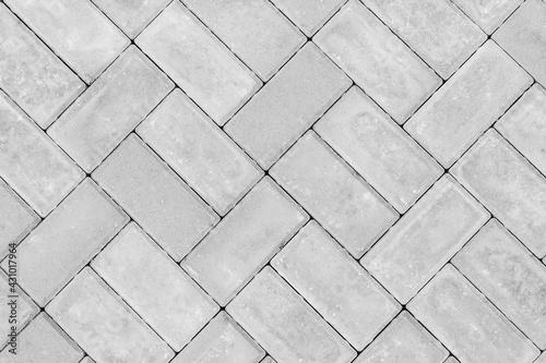Photo Gray paving slabs urban street road floor stone tile texture background, top vie