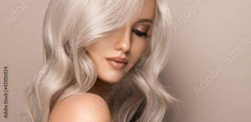 Valokuvatapetti Beautiful girl with hair coloring in ultra blond