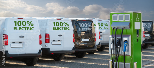 Fotografia Electric vehicles charging station on a background of a row of vans