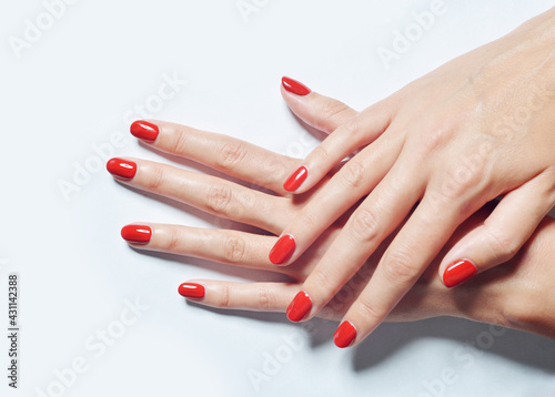 Canvas Print Closeup shot of female hands with red nail polish