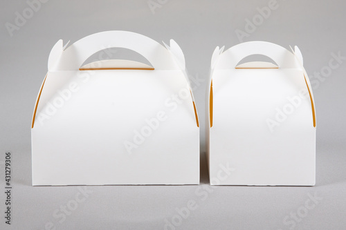 Fototapeta closed cardboard two white mock up pastry box transport cakes isolated on grey b