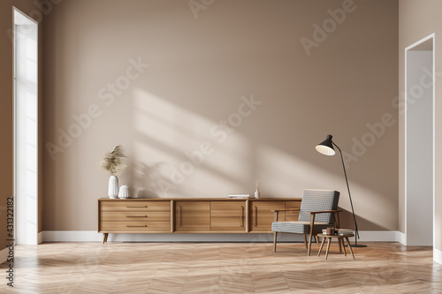 Living room interior with cozy armchair, panoramic window and sideboard