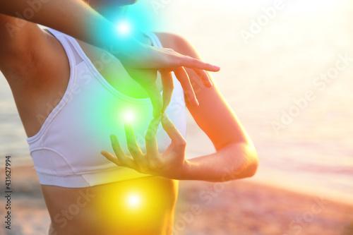 Foto Beautiful young woman practicing yoga near river