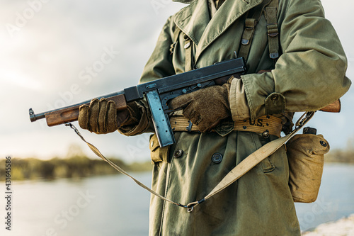Fototapeta Soldier Of USA Infantry Of World War II Holds Submachine Weapon In Hands