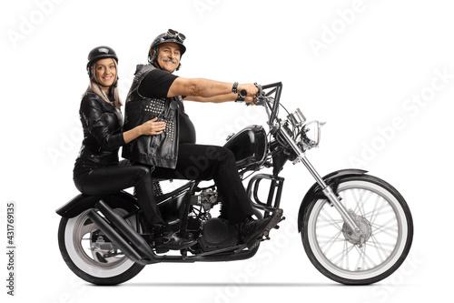 Full length profile shot of a mature biker and a young woman on a custom chopper Fototapet