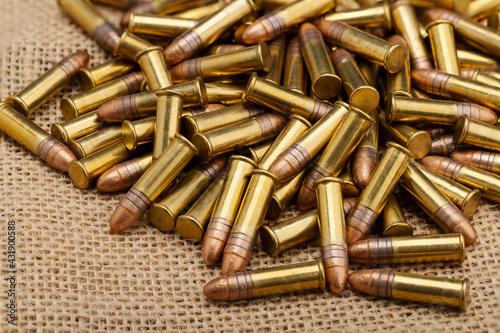 Wallpaper Mural Close up of .22 ammunition on burlap background , .22 LR bullets