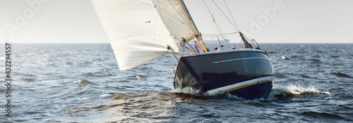 Heeled sloop rigged yacht sailing in an open Baltic sea on a clear day. Regatta, racing, sport, recreation, leisure activity, transportation, nautical vessel, adventure