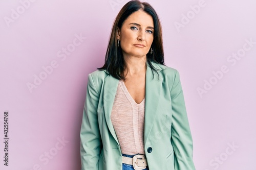Fotografie, Obraz Middle age brunette woman wearing casual clothes relaxed with serious expression on face