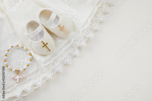 Canvas Christening background with baptism baby dress, shoes, and cross on pastel backg