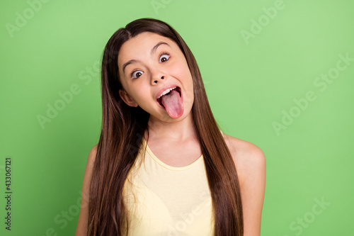 Wallpaper Mural Portrait of young satisfied person open mouth tongue out look camera isolated on