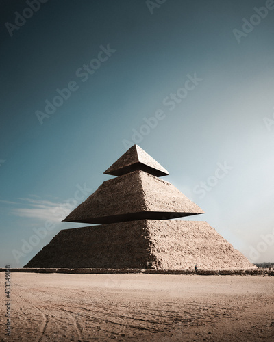 Fototapeta Abstract surrealistic image of an old Egyptian pyramid cut into three pieces