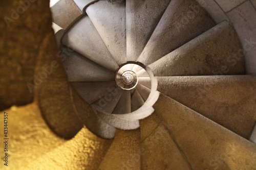 Fotografie, Obraz underside of a spiraling stair case in a tower