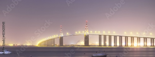 Canvas Panoramic view of illuminated cable-stayed Saint-Nazaire bridge at night